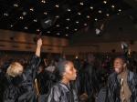 Graduates toss their caps in celebration!