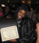 Octavia shows off her diploma