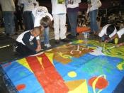 Volunteers painting the commemorative mural