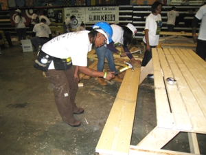 YouthBuild students put the finishing touches on a picnic table