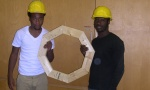 Students Denzelle and Raheem showing a frame they constructed