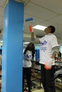 Painting columns in the cafeteria