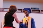 Class Valedictorian Derrick Davenport receives his diploma
