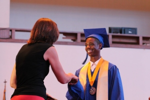 Class Valedictorian Derrick Davenport receives his diploma