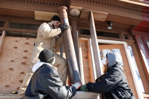 YouthBuild students preserved history by restoring the porch of the John Coltrane House.